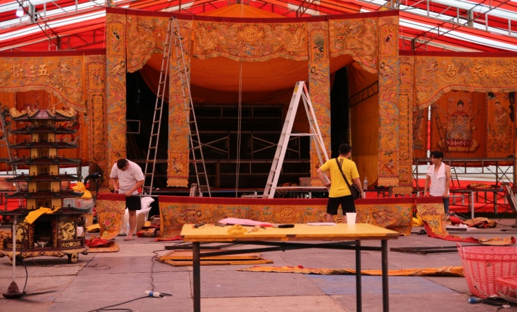 The setting up process involves raising the various banners of the different deities and laying out the altars.