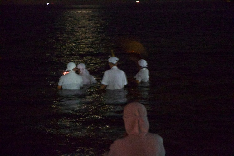 Part of the ritual during the receiving requires the key members of the temple to enter the sea to retrieve the Urn.