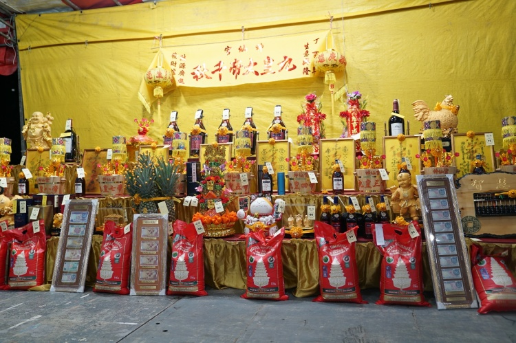 The items up for auctions include wine, talisman, rice bucket, rice packs and many other auspicious items.