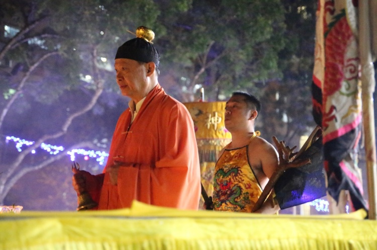 The Taoist priest, together with the Nine Emperor Gods spirit medium performing the ritual to raise the Nine Lamps.